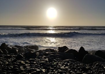 Deezal Photography Sea Beauty Photography beach, sunset, rocks, sea, waves, sun, ocean, water, silhouette, colours, orange, yellow, blue personalised online greeting card