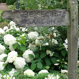 Photography Secret garden, signpost, gardening, white flowers, floral, gardener, mum, dad, birthday, lady, mother personalised online greeting card
